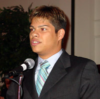 Carlos Vale accepts ICCTA's 2004 Gigi Campbell Student Trustee Excellence Award.
