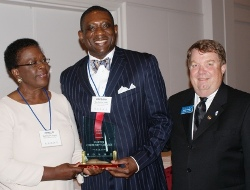 Dr. Gregory James (center) of Oakton Community College accepts ICCTA's 2010 Equity Award from ICCTA Equity Committee chair Phyllis Folarin and ICCTA vice president David Harby.