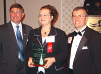 Kathy Sturgeon of Danville Area Community College accepts ICCTA's 2006 Outstanding Faculty Member Award from Illinois Community College Board chair Guy Alongi (left) and ICCTA president Tom Bennett.