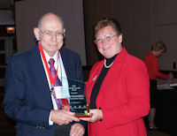John McDowell accepts ICCTA's 2009 Lifelong Learning Award from ICCTA president Barbara Oilschlager.